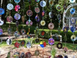 Old CDs made into a pretty hanging garden ornament